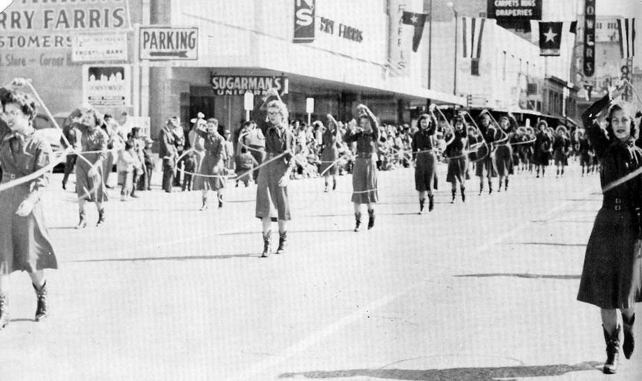 Lassos march in a parade for the San Antonio Stock Show & Rodeo, 1958. Photo: Courtesy Photo,      Lasso Alumni Association
