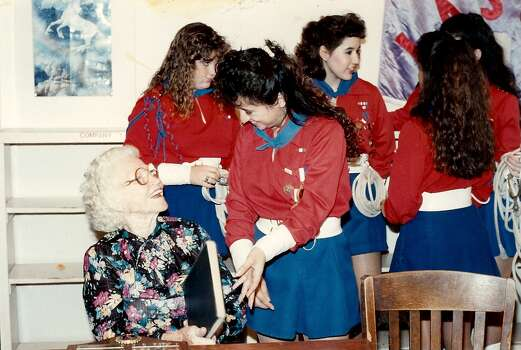 1989 Lasso roping team captain Rita Leos Gomez visits with former Lasso director Bess Richards. Photo: Courtesy Photo,      Lasso Alumni Association