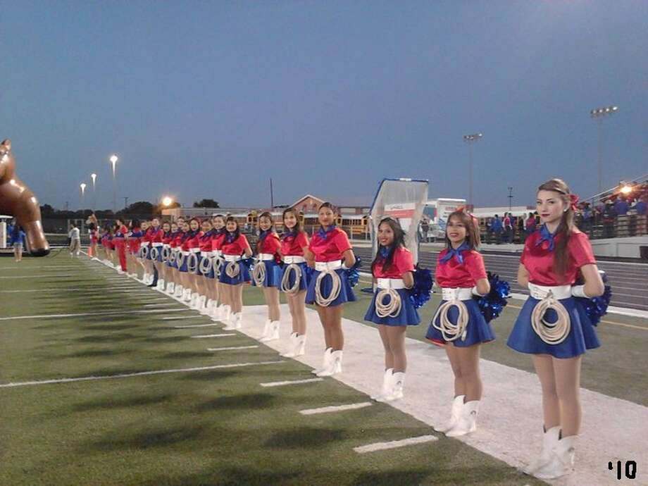 Lassos wait to greet the Jefferson Mustang football team, 2010. Photo: Courtesy Photo,      Lasso Alumni Association