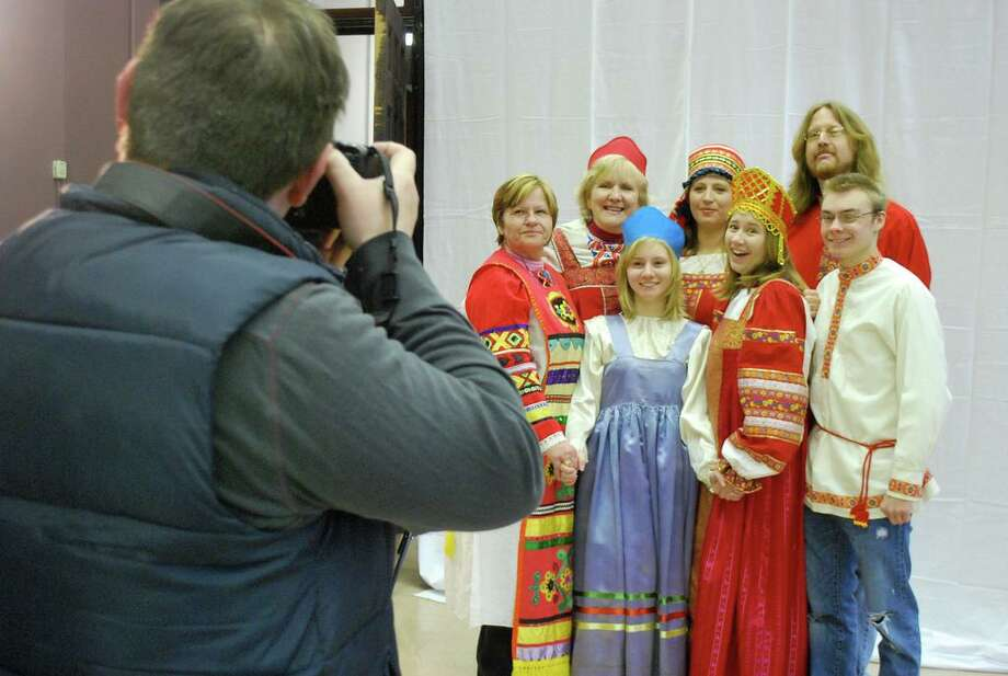Family takes picture wearing traditional Russian costumes (Courtesy of New Russia Cultural Center)
