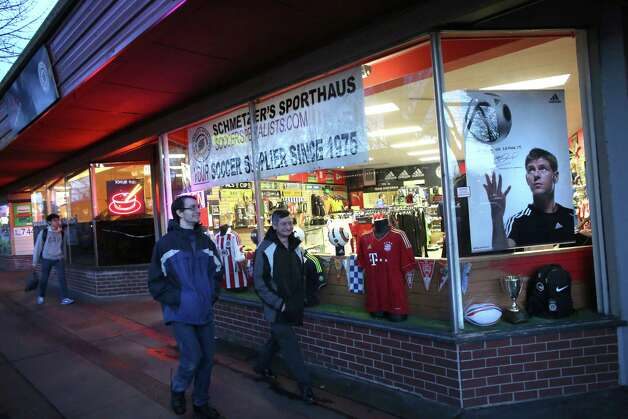 Pedestrians walk past Schmetzer's Sporthaus soccer store on Thursday,  February 25, 2013 in Seattle's Lake City neighborhood. After decades of  serving NE Seattle with soccer gear, the store will relocate to Aurora  Avenue. Staff there said they were moving to a larger space and partly  because of the chronic inebriates and drug users that linger in front of  the store. Photo: JOSHUA TRUJILLO / SEATTLEPI.COM