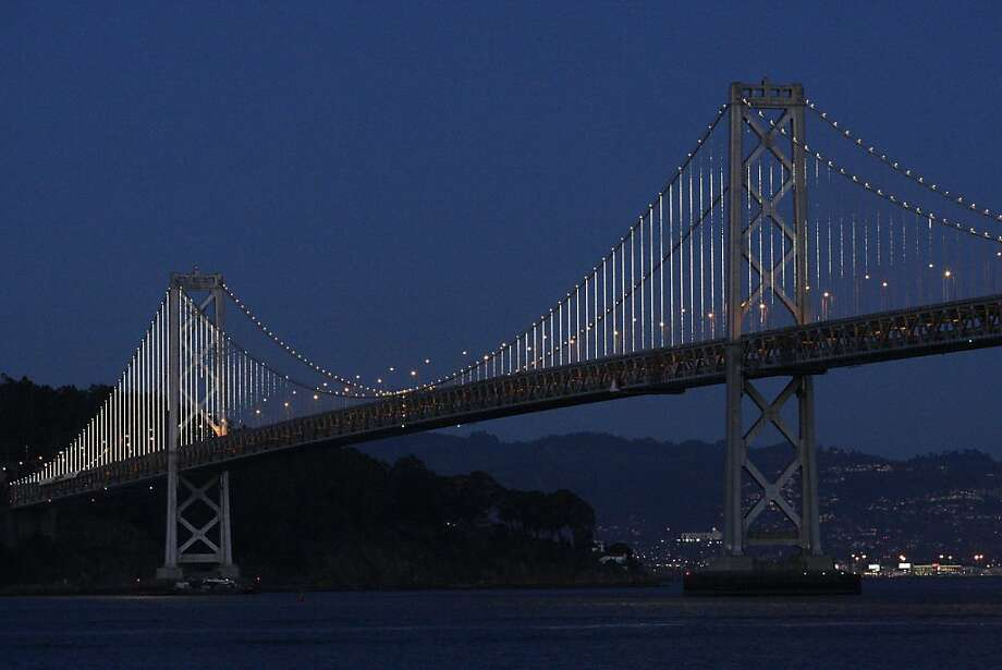 25,000 LED lights illuminate the Bay Bridge in preparation  for the bridge's anniversary ceremony on March 5. Photo: James Tensuan, The Chronicle