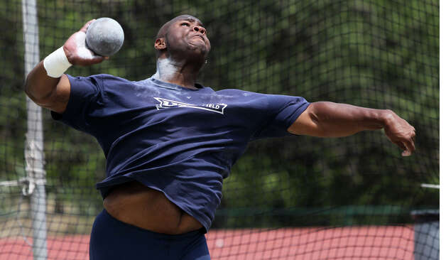 UTSA shot putter Richard Garrett, Jr. practices on campus Monday May 9, 2011. Garrett is the school's record holder for indoor and outdoor shot put and broke a 25-year-old school record for throwing the discus at the Texas relays. (Monday May 9, 2011) JOHN DAVENPORT/jdavenport@express-news.net Photo: JOHN DAVENPORT, SAN ANTONIO EXPRESS-NEWS / SAN ANTONIO EXPRESS-NEWS (Photo can be sold to the public)