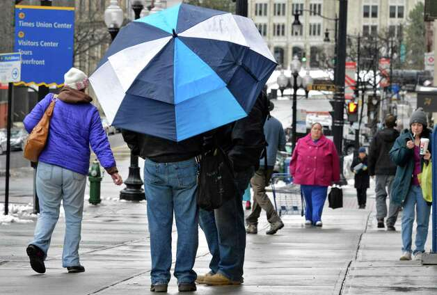 Pedestrians brave rain and cold along State Street in Albany Wednesday Feb. 27, 2013.  (John Carl D'Annibale / Times Union) Photo: John Carl D'Annibale / 00021330A