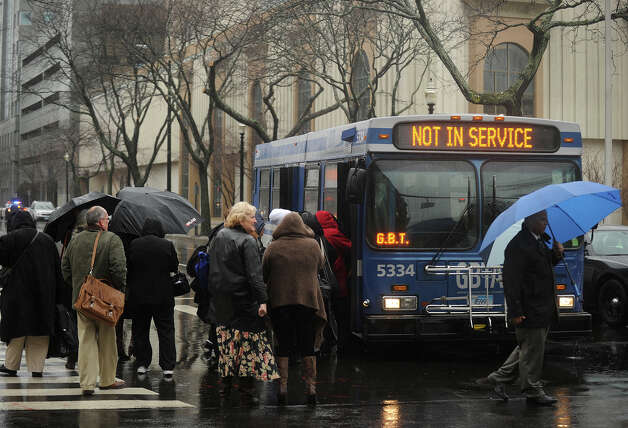 Margaret E. Morton Government Center employees are evacuated on to a city bus on State Street in downtown Bridgeport after an inert explosive device was discovered in the building on Wednesday, February 27, 2013. Photo: Brian A. Pounds / Connecticut Post