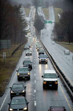 Traffic is backed up on the Merritt Parkway after a tree fell into the roadway in New Canaan, Conn., on Wednesday, February 27, 2013. Photo: Lindsay Perry / Stamford Advocate