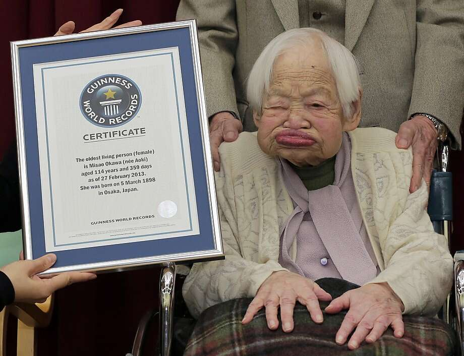 Across three centuries:At 114, Japan's Misao Okawa is the oldest woman in the world, according to Guinness. She was presented with her official world record certificate at a nursing home in Osaka. Photo: Itsuo Inouye, Associated Press