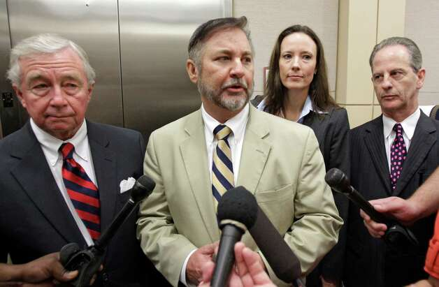 Criminal defense attorney Dick Deguerin, left, with client Michael Brown, and criminal defense attorneys Catherine Baen, and  Brian Wice, right, as they talk to the media as they leave the courtroom after Brown was found not guilty of assault in trial at the Harris County Criminal Justice Center, 1201 Franklin,  Tuesday, Sept. 20, 2011, in Houston.  Brown, a former hand surgeon, was accused of assaulting his fourth wife, Rachel Brown, last year in their Memorial-area mansion.  ( Melissa Phillip / Houston Chronicle ) Photo: Melissa Phillip, Staff / © 2011 Houston Chronicle