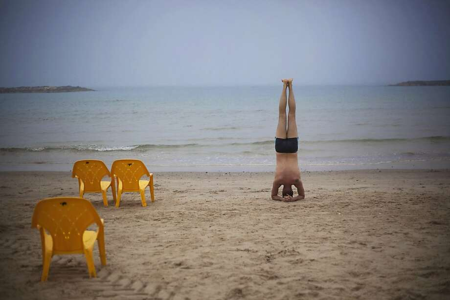 A man exercises moments before swimming in the Mediterranean sea in Tel Aviv, Israel, Wednesday, Feb. 27, 2013. Photo: Ariel Schalit, Associated Press