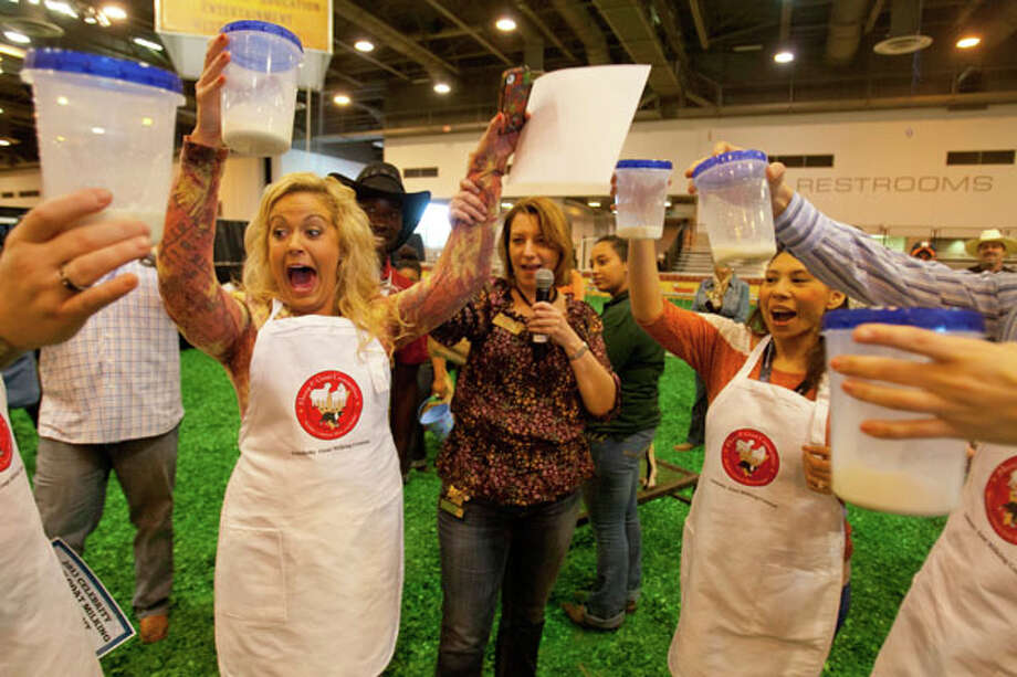 (center) Maggie Flecknoe of KIAH Channel 39 holds up her jar of goat milk as the judges determine the winner. Photo: Billy Smith II, Houston Chronicle / © 2013  Houston Chronicle