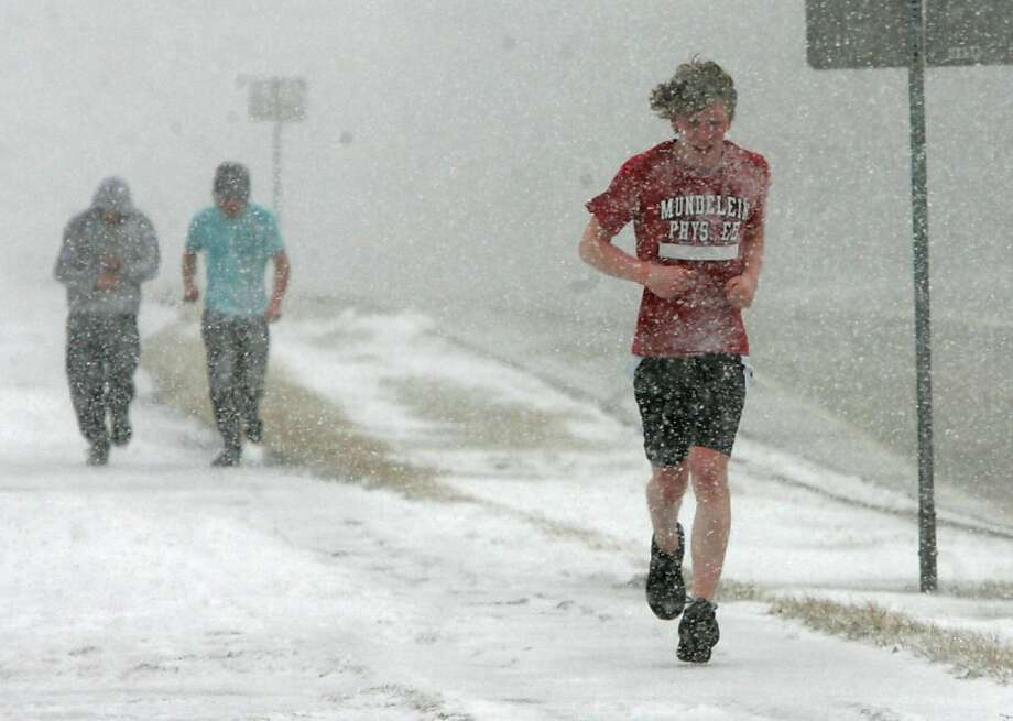 Pick up the pace, boys, before the frostbite sets in: Phys. ed. class at Mundelein High School in Mundelein, Ill., is not for the faint of heart. Photo: Gilbert R. Boucher II, Associated Press