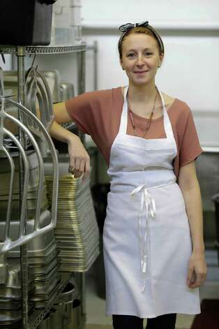 In this Thursday, Feb. 21, 2013 photo, Christina Tosi, pastry chef and founder of Momofuku Milk Bar, poses for a picture at the Milk Bar kitchen in New York. Cereal is going out of the box. Milk, ice cream, muffin mix and more are being infused with the flavor of the classic childhood treat. (AP Photo/Seth Wenig) Photo: Seth Wenig