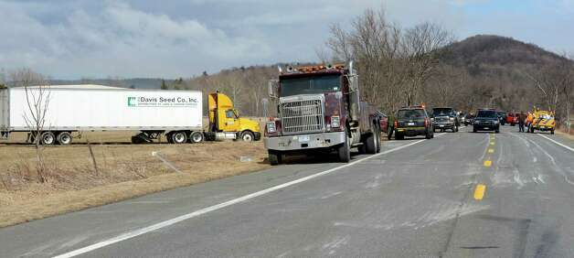 A Davis Seed company tractor trailer sits in a field north of Route 22 Feb. 27, 2013 after being blown from road by high winds in Copake, N.Y.  (Skip Dickstein/Times Union) Photo: SKIP DICKSTEIN