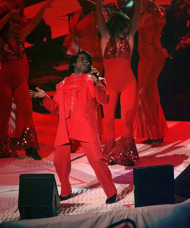 FILE -In this Sunday, Jan. 26, 1997 file photo, James Brown performs during the halftime show at Super Bowl XXXI between the Green Bay Packers and New England Patriots, in New Orleans. The South Carolina Supreme Court on Wednesday, Feb. 27, 2013, overturned a settlement divvying up the multimillion-dollar estate of James Brown, saying a former attorney general didn't follow the late soul singer's wishes in putting together the deal. (AP Photo/Mark Duncan, File) Photo: MARK DUNCAN