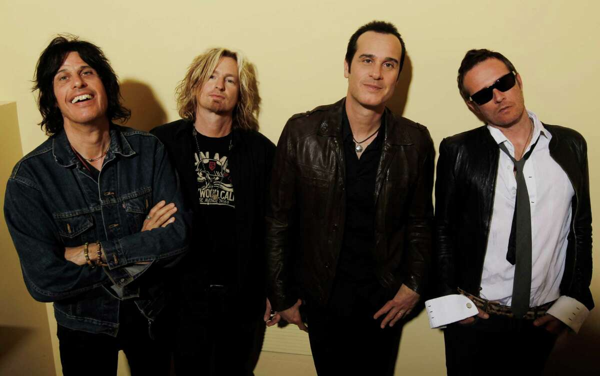 FILE - This April 30, 2010 file photo shows the Stone Temple Pilots, from left, Dean Deleo, Eric Kretz, Robert Deleo, and Scott Weiland from the band Stone Temple Pilots, pose for a portrait in Santa Monica, Calif. In a one-sentence news release on Wednesday, Feb. 27, 2013, publicist Kymm Britton said: