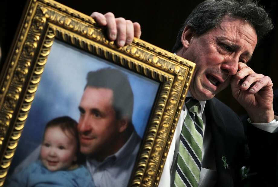 Neil Heslin, father of six-year-old Sandy Hook Elementary School shooting victim Jesse Lewis, wipes tears as he testifies during a hearing before the Senate Judiciary Committee February 27, 2013 on Capitol Hill in Washington, DC. The committee held a hearing on The Assault Weapons Ban of 2013.