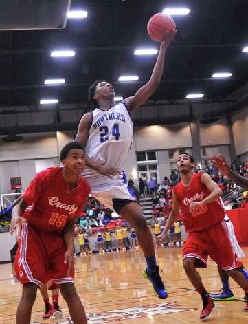 The Ozen High School boys basketball team played Crosby High School at 7 p.m. Tuesday night in a Class 4A regional quarterfinal game at Lee College in Baytown. The winner of this game advanced to the Class 4A Region III semifinals.  Ozen lost the game 53-50. Dave Ryan/The Enterprise Photo: Dave Ryan