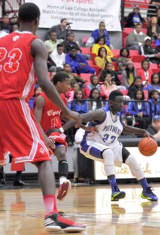 The Ozen High School boys basketball team played Crosby High School at 7 p.m. Tuesday night in a Class 4A regional quarterfinal game at Lee College in Baytown. The winner of this game advanced to the Class 4A Region III semifinals.  Ozen lost the game 53-50. Dave Ryan/The Enterprise