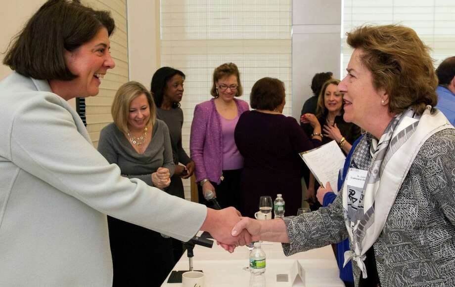 "Panelist Kathleen McQuiggan greets an attendee after ""Women Inspiring Women - Philanthropy Driving Results,"" a panel discussion held by UBS Wealth Management Americas and the Fairfield County Community Foundation at UBS on Wednesday, February 27, 2013. Photo: Lindsay Perry / Stamford Advocate"