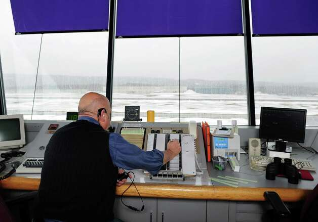 An air traffic controller works at Waterbury-Oxford Airport in Oxford, Conn. Wednesday, Feb. 27, 2013.  The Federal Aviation Administration (FAA) will begin furloughing air traffic controllers March 1 because of looming automatic spending cuts which will affect six airports in Connecticut and about 190 airports nationwide. Photo: Autumn Driscoll / Connecticut Post