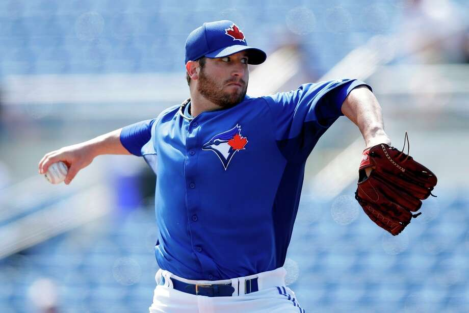 Blue Jays pitcher Brad Lincoln works in the first inning. Photo: Matt Slocum