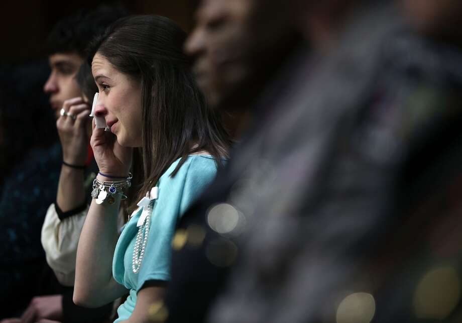 Jillian Soto, sister of Sandy Hook Elementary shooting victim first-grade teacher Victoria Soto, wipes tears during a hearing before the Senate Judiciary Committee February 27, 2013 on Capitol Hill in Washington, DC. The committee held a hearing on The Assault Weapons Ban of 2013.