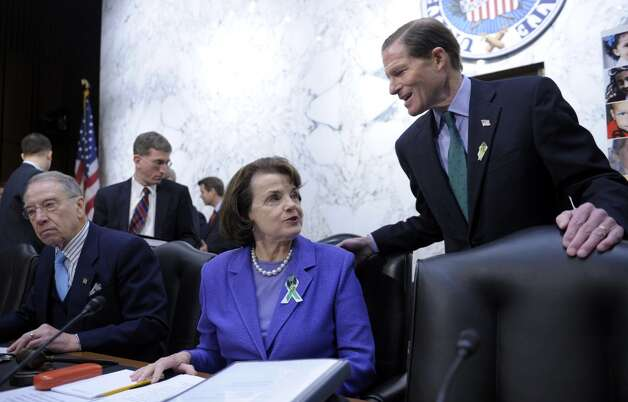 Senate Judiciary Committee members, Sen. Dianne Feinstein, D-Calif., center, sitting next to the committee's ranking Republican, Sen. Charles Grassley, R-Iowa, left, talks with Sen. Richard Blumenthal, D-Conn., on Capitol Hill in Washington, Wednesday, Feb. 27, 2013, prior to the start of the committee's hearing on the Assault Weapons Ban of 2013.