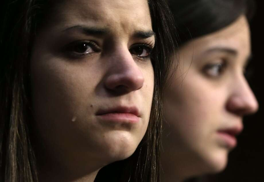 Sisters of Sandy Hook Elementary shooting victim first-grade teacher Victoria Soto, Jillian Soto (R) and Carlee Soto (L) listen during a hearing before the Senate Judiciary Committee February 27, 2013 on Capitol Hill in Washington, DC. The committee held a hearing on The Assault Weapons Ban of 2013.