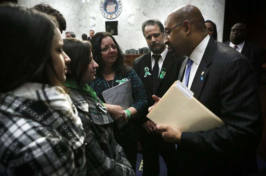 Mayor of Philadelphia and president of the U.S. Conference of Mayors Michael Nutter (R) talks to family of Sandy Hook Elementary shooting victim first-grade teacher Victoria Soto, sisters Carlee (L) and Jillian (2nd L), mother Donna (3rd L) and father Carlos (4th L) after a hearing before the Senate Judiciary Committee February 27, 2013 on Capitol Hill in Washington, DC. The committee held a hearing on The Assault Weapons Ban of 2013.