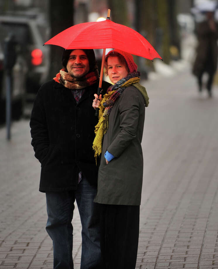 Christopher and Marcella Cavaliere of Bridgeport share an umbrella on Broad Street in downtown Bridgeport on Wednesday, February 27, 2013. Photo: Brian A. Pounds / Connecticut Post