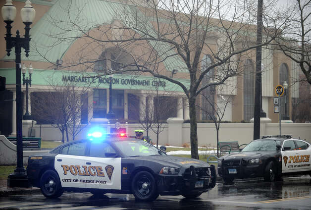 Police secure the Margaret E. Morton Government Center on Broad Street in downtown Bridgeport, evacuated after an inert explosive device was discovered on Wednesday, February 27, 2013. Photo: Brian A. Pounds / Connecticut Post