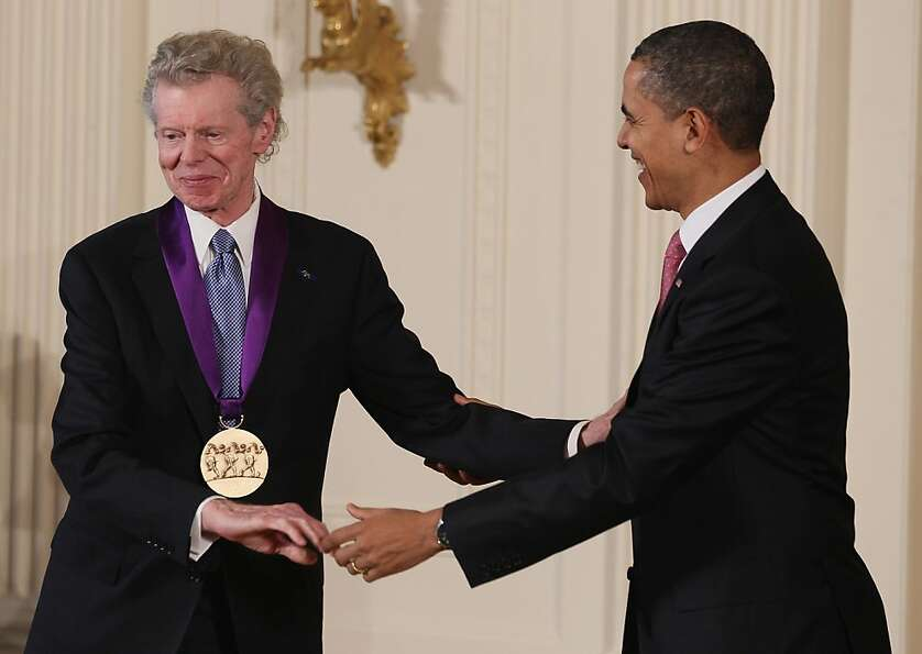 President Barack Obama (right) congratulates musician Van Cliburn after presenting him with the 2010