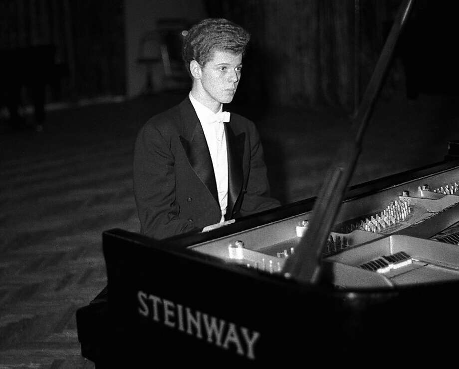 This April 11, 1958 file photo shows pianist Van Cliburn performing in final round of Tchaikovsky International Piano & Violin competition in Moscow.  Cliburn, the internationally celebrated pianist whose triumph at a 1958 Moscow competition helped thaw the Cold War and launched a spectacular career that made him the rare classical musician to enjoy rock star status  died early Wednesday, Feb. 27, 2013, at his Fort Worth home following a battle with bone cancer.  He was 78. Photo: Associated Press