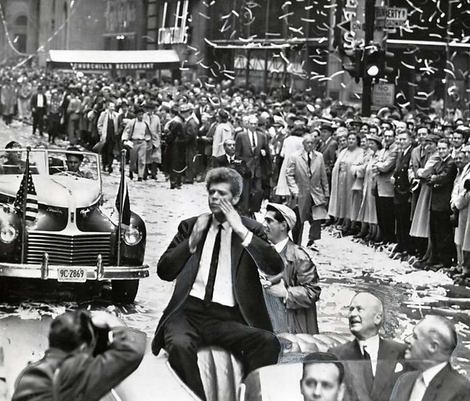 Van Cliburn, the 23-year-old Texas Pianist who won acclaim in a Moscow competition, blows kisses with both hands as he is paraded up Broadway in a traditional ticker tape reception on May 21, 1958. The young artist, from Kilgore, Texas was feted by the city in a reception of the type usually reserved for military heroes, athletic champions and visiting royalty. Photo: HANDOUT