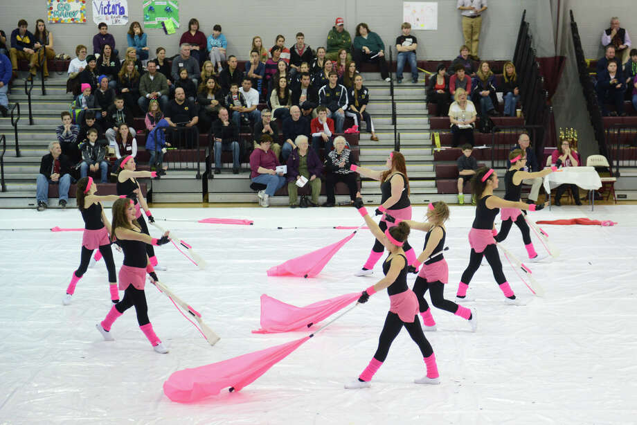 The Newtown High School junior varsity winter guard team performs at the Bethel Winterguard Home Show at Bethel High School in Bethel, Conn. Saturday, Feb. 23, 2013. The next Winterguard event, with 35 teams registered to compete, is at Newtown High School on March 2, 2013 at 3 p.m. Admission is $10. Photo: Tyler Sizemore / The News-Times