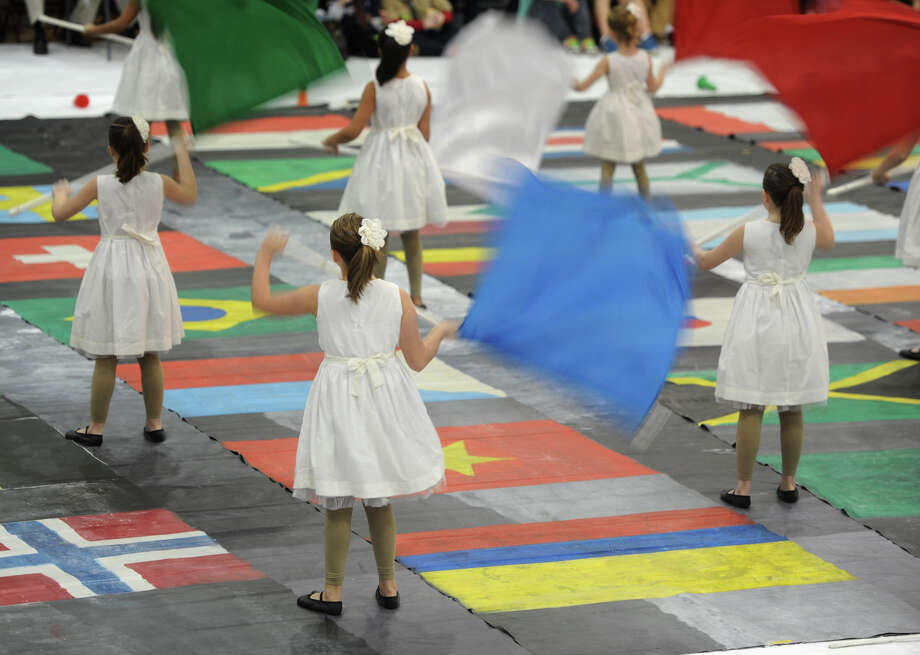 The Bethel junior winter guard team performs at the Bethel Winterguard Home Show at Bethel High School in Bethel, Conn. Saturday, Feb. 23, 2013. Photo: Tyler Sizemore / The News-Times