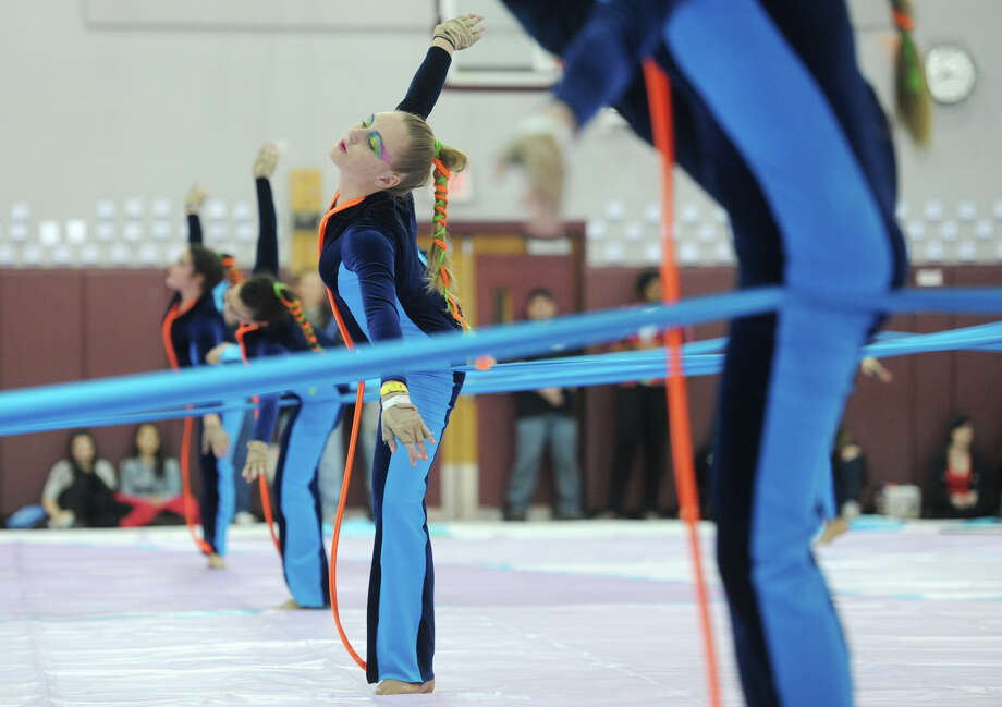 The Arlington High School winter guard team performs at the Bethel Winterguard Home Show at Bethel High School in Bethel, Conn. Saturday, Feb. 23, 2013.  Arlington High School scored a 77.60, the highest score in all divisions competing. Photo: Tyler Sizemore / The News-Times