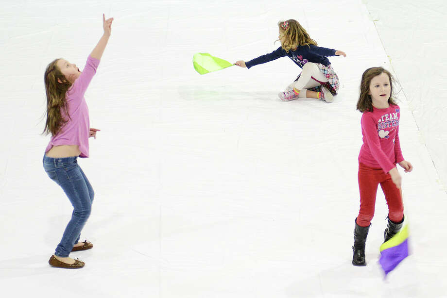 From left: Ava Kerrigan, 7, of Bethel, Conn.; Summer Wise, 6, of Bethel, Conn.; and Aislyn Wachnuik, 6, of Bethel, Conn. play around on the mat during intermission at the Bethel Winterguard Home Show at Bethel High School in Bethel, Conn. Saturday, Feb. 23, 2013. Photo: Tyler Sizemore / The News-Times