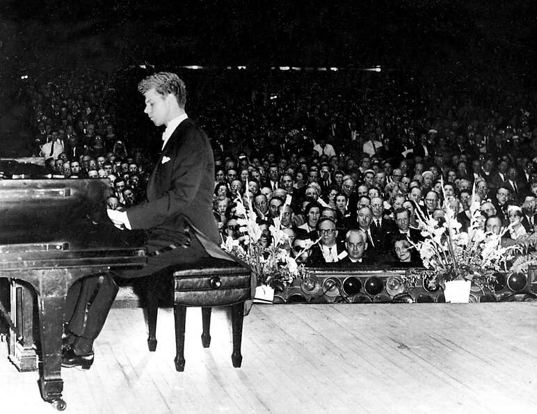This Feb. 19, 1959 file photo shows pianist Van Cliburn performing for the American Association of S