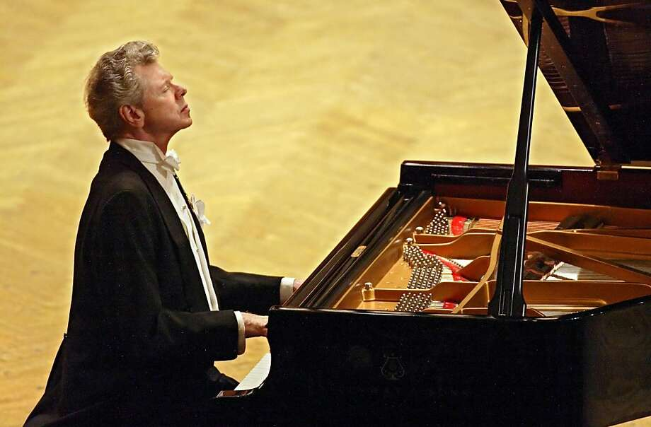 This Sept. 21, 2004 file photo shows pianist Van Cliburn performing during at a concert dedicated to the memory of the victims of the recent Beslan school massacre in Moscow.  Cliburn, the internationally celebrated pianist whose triumph at a 1958 Moscow competition helped thaw the Cold War and launched a spectacular career that made him the rare classical musician to enjoy rock star status  died early Wednesday, Feb. 27, 2013, at his Fort Worth home following a battle with bone cancer.  He was 78. Photo: Sergey Ponomarev, Associated Press
