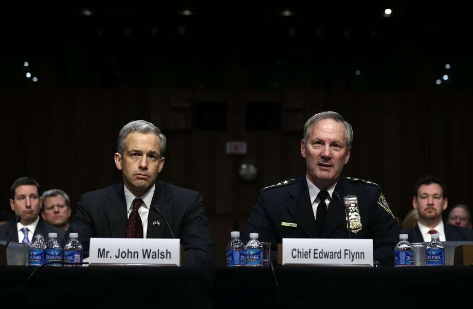 U.S. attorney of the District of Colorado John Walsh (L) and Chief of the Milwaukee Police Department Edward Flynn (R)  testify during a hearing before the Senate Judiciary Committee February 27, 2013 on Capitol Hill in Washington, DC. The committee held a hearing on The Assault Weapons Ban of 2013.