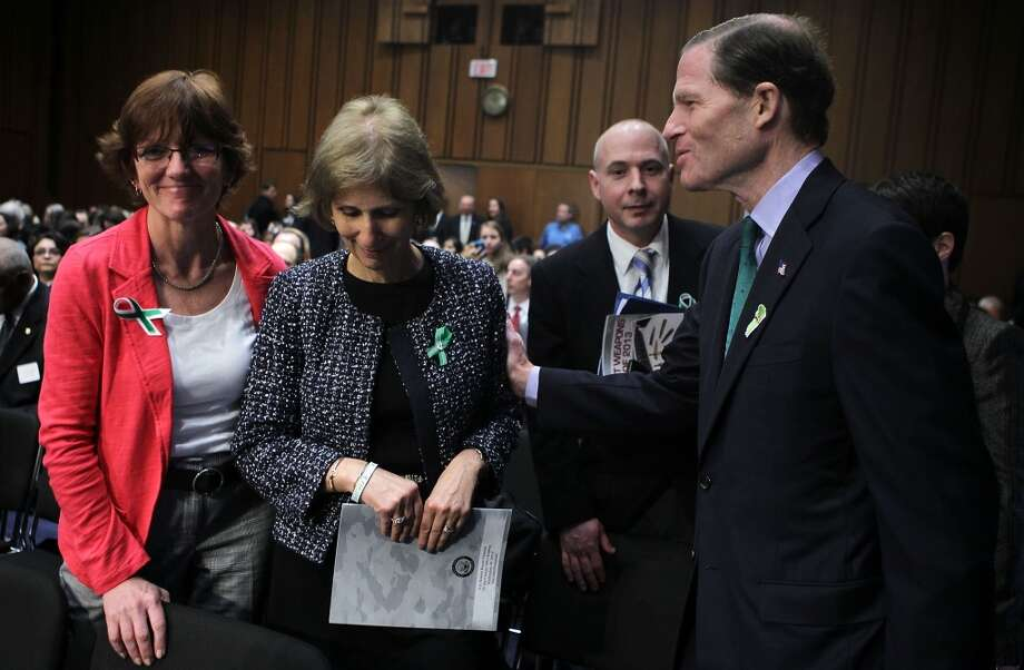U.S. Sen. Richard Blumenthal (D-CT) (R) greets Newtown, Connecticut, middle school teachers Mary Connolly (L) and Lil Martenson (2nd L) prior to hearing before the Senate Judiciary Committee February 27, 2013 on Capitol Hill in Washington, DC. The committee held a hearing on The Assault Weapons Ban of 2013.