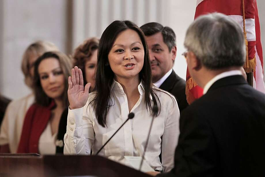 Mayor Ed Lee swears in Carmen Chu as the new assessor-recorder. At a supervisorial send-off, Chu was teased for her love of McDonald's and lack of knowledge about LGBT slang. Photo: Michael Macor, The Chronicle