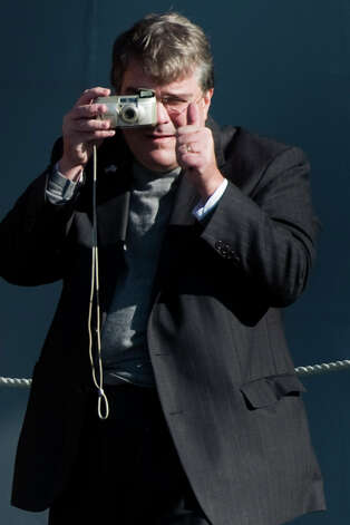 Congressman John Culberson gives a thumbs up as he snaps a photography during commissioning ceremonies for the USS  George H.W. Bush aircraft carrier at the at Naval Station Norfolk,  Saturday, Jan. 10, 2009, in Norfolk. Photo: Smiley N. Pool, Houston Chronicle / Houston Chronicle