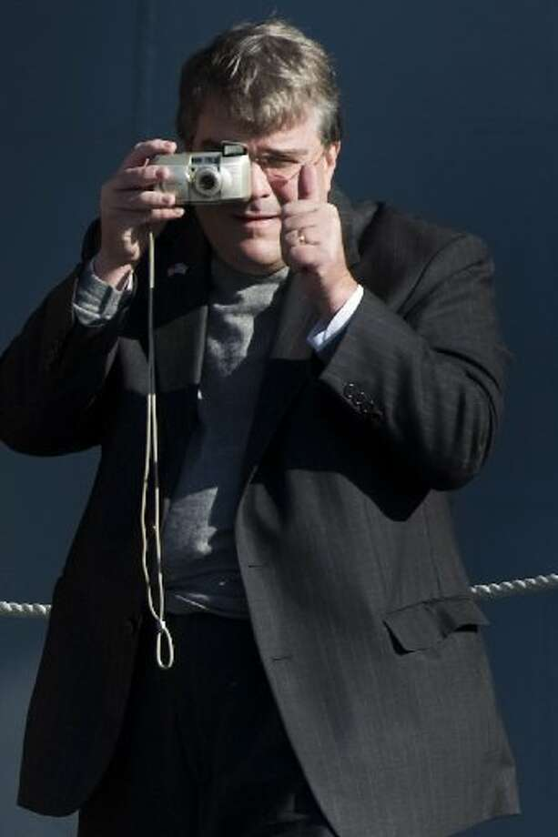 Congressman John Culberson gives a thumbs up as he snaps a photography during commissioning ceremonies for the USS George H.W. Bush aircraft carrier at the at Naval Station Norfolk, Saturday, Jan. 10, 2009, in Norfolk.