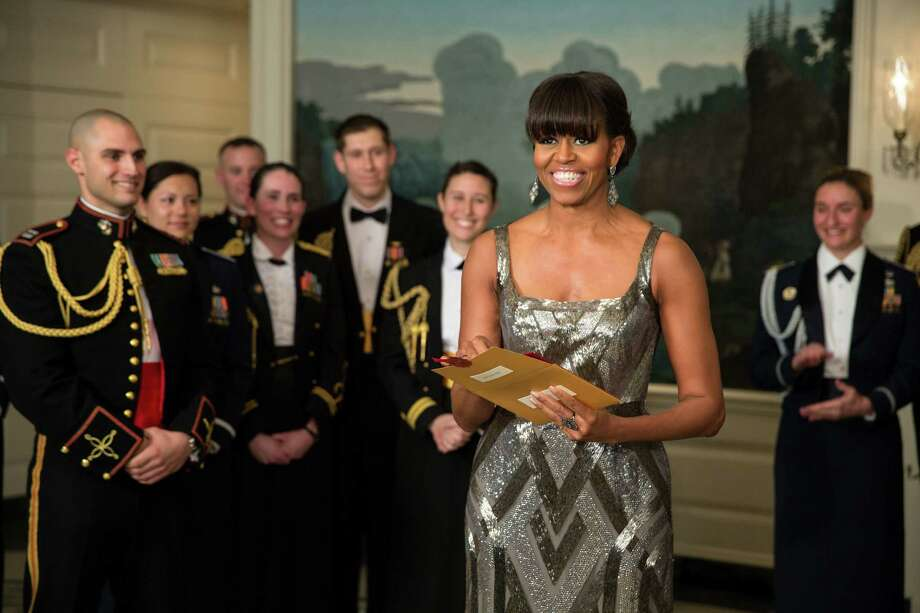 """Michelle Obama announces the Best Picture Oscar. The night's question about her was, """"What's she done with her hair?"""" Bangs might signify a more fun-loving second stint as first lady. Photo: The White House, Getty Images"""