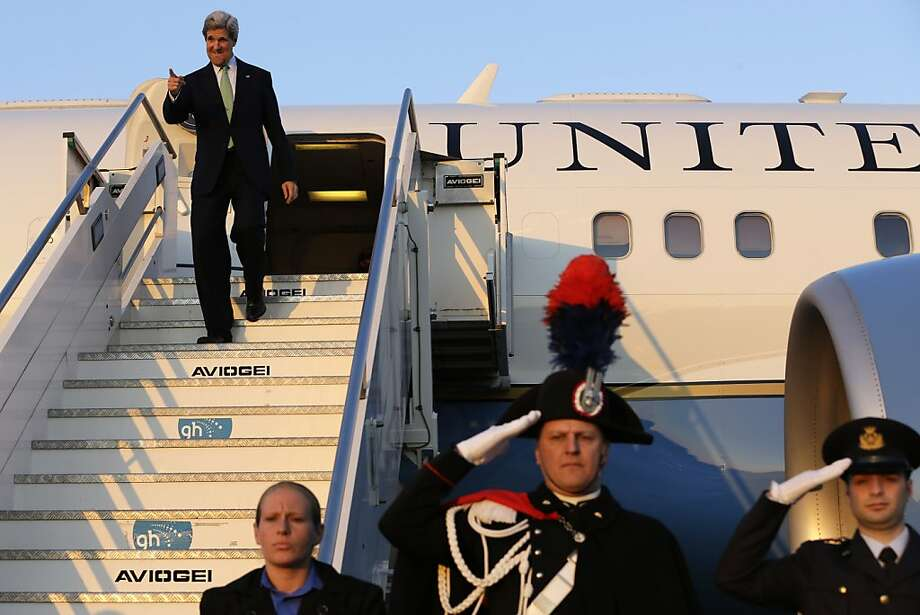 U.S. Secretary of State John Kerry gestures as he disembarks the plane, on his arrival at Ciampino Airport, in Rome on Wednesday, Feb. 27, 2013. where talks on Syria will be held. Rome is the fourth leg of Kerry's first official overseas trip, a hectic nine-day dash through Europe and the Middle East. (AP Photo/Jacquelyn Martin, Pool) Photo: Jacquelyn Martin, Associated Press