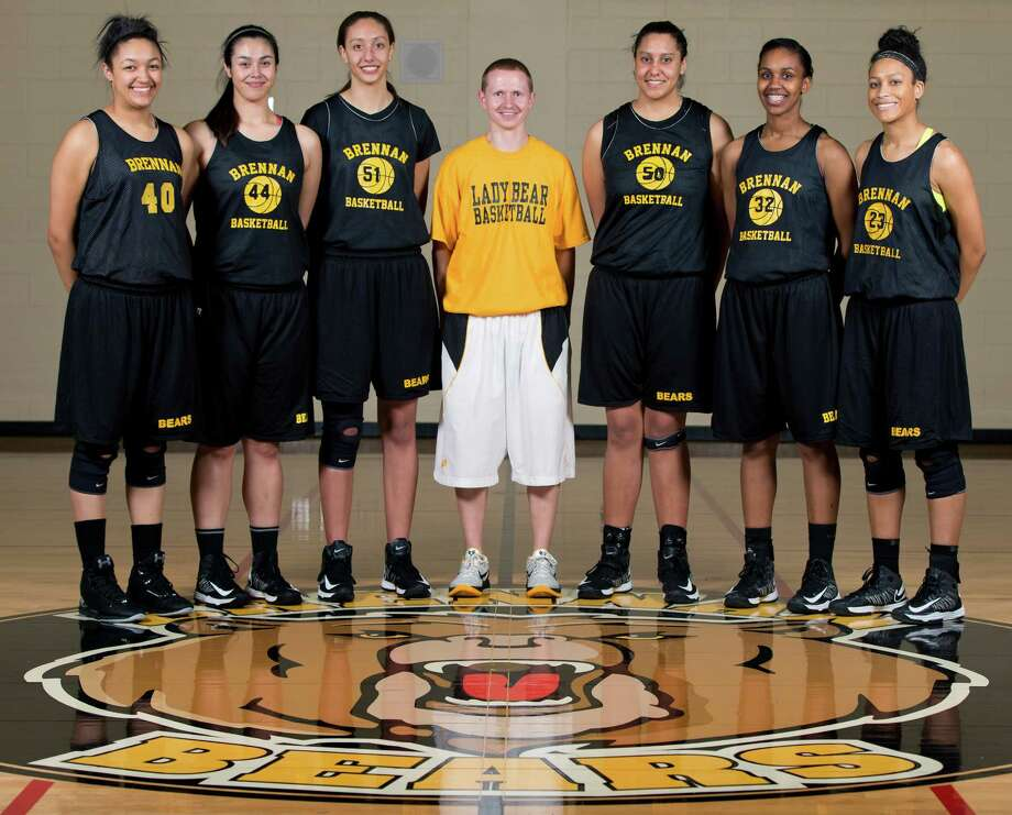 Brennan High School coach coach Koty Cowgill, center, poses Tuesday Feb. 26, 2013 surrounded by the six tallest member of the Bears' team heading to the state tournament this weekened. They are, from left: Monique Terry, Eliza Martinez, Deja Mason, Tia Mason, Tanaeya Boclair, Kiara Etheridge Photo: William Luther, San Antonio Express-News / @2013 San Antonio Express-News