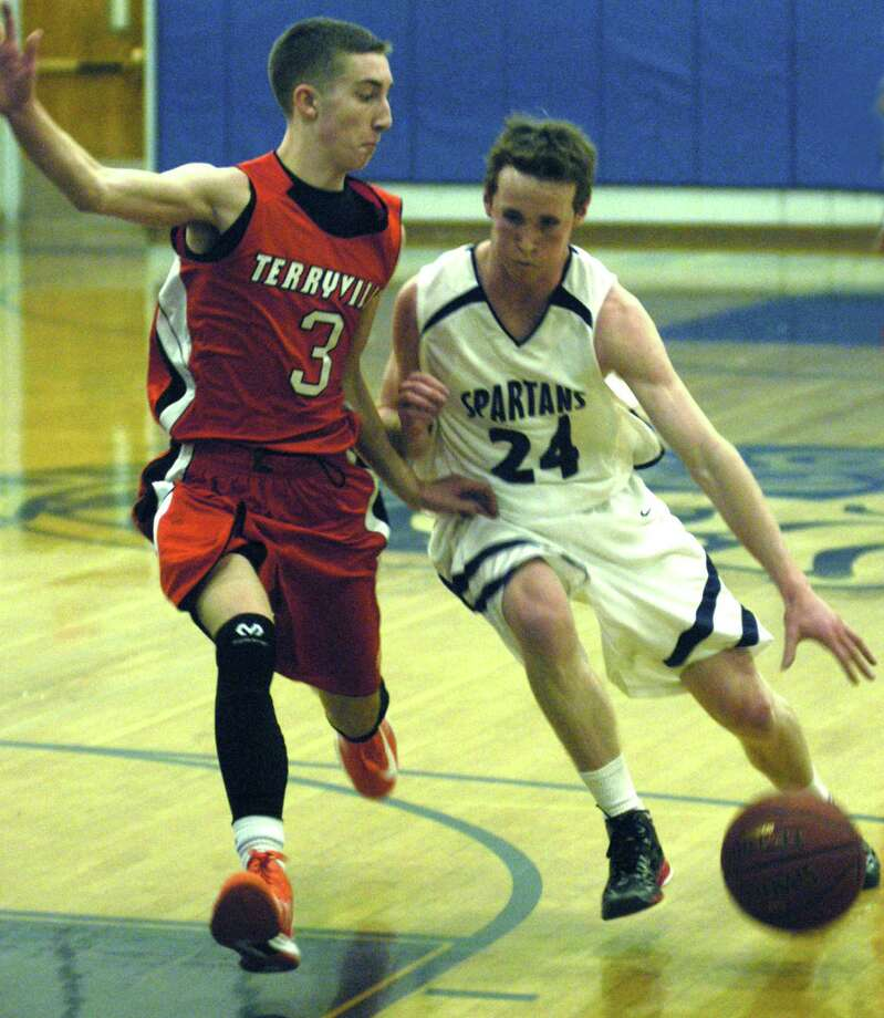 Dylan McAward of the Spartans tests the defensive footwork of the Kangaroos' Tyler Trillo during Shepaug Valley High School boys' basketball's Feb. 13, 2013 game vs. Terryville in Washington. Photo: Norm Cummings