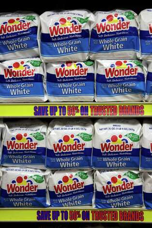 FILE- In this Wednesday, Jan. 11, 2012, file photo, Hostess Brands Wonder breads are displayed at a grocery store in Santa Clara, Calif. A person familiar with the situation says a bid by Flowers Foods to buy Wonder and several other bread brands from Hostess was met with no competing offers on Tuesday, Feb. 27, 2013. The individual requested anonymity because the auction process is private. (AP Photo/Paul Sakuma, File) Photo: Paul Sakuma